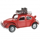 Retro VW Style Beetle With Luggage On Roof Rack