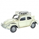 Retro VW Style Beetle With Spare Wheels On Roof Rack