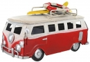 Retro Small Shabby Chic Camper Van With Surfboard And Life Belt On Roof Rack